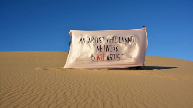 Anca Benara & Arnold Estefan, An Artist Who Cannot Network Is No Artist (d'apres Mladen Stilinovic), 2015. Flag (acrylic on artificial silk), 150 x 250 cm